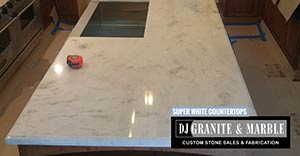 Quartzite: 3CM Super White kitchen island farmers sink 2