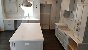 Quartzite: super white island kitchen